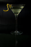 Martini with a twist on black Royalty Free Stock Images