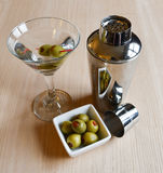 Martini with two olives with silver cocktail shaker Stock Photo
