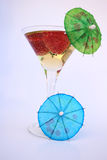 Martini & Umbrella. Martini Glass with Apple Juice and umbrellas Royalty Free Stock Image
