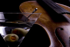 Martini with Violin. Martini glass with violin background stock photography