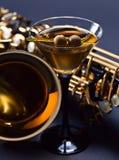 Martini y saxofón Imagenes de archivo