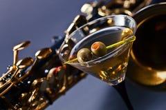 Martini y saxofón Imágenes de archivo libres de regalías