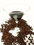 Martiniglass glass liqueur beans coffeebeans Royalty Free Stock Photos