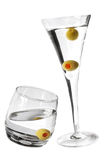 Martinis. Two martinis with olives and white background Royalty Free Stock Images