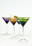 Martinis in colorful glasses Stock Photos