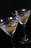 Martinis with olives. Martini glasses with olives on a black studio background Royalty Free Stock Photo