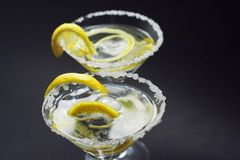 Martinis with sugar crust, lemon and peels Royalty Free Stock Images