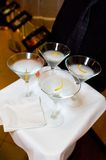 Martinis on a Tray. A tray of four martinis held up by a waiter Stock Image
