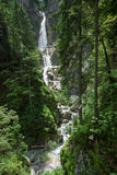 Martuljek waterfalls surrounded by forest Slovenia Royalty Free Stock Photography