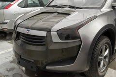 Marussia F2 frontowy widok Fotografia Rosyjski supercar SUV na parking Obrazy Stock