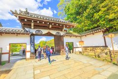 Maruyama Park gate. Kyoto, Japan - April 24, 2017: people crossing gate to entrance of Maruyama Park coming from the famous Chion-in Sanmon. Maruyama Park is the Stock Image