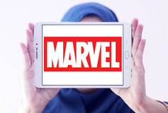 Marvel logo. Logo of marvel cinema studios on samsung tablet holded by arab muslim woman Royalty Free Stock Photos