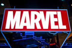 Marvel logo in Hamleys store. Marvel Comics Group is a publisher of American comic books and related media royalty free stock photos