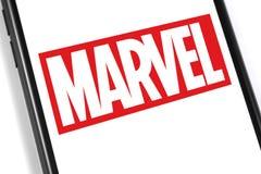 Marvel logo on the screen smartphone stock image