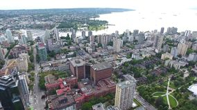 Marvellous 4k aerial drone view on Vancouver modern architecture skyscraper by river downtown cityscape seascape skyline. Marvellous aerial drone view on stock footage