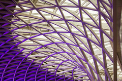 The marvellous Kings Cross ceiling architecture. The marvellous purple architecture of the Kings Cross station in London, Great Britain Stock Photos