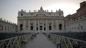 Marvellous St. Peter's Basilica in Vatican City. Chairs positioned and setted for special occasion in the square of St. Peter's Basilica in Vatican City stock footage