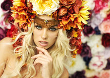 Marvelous blonde woman with flower hat Royalty Free Stock Images