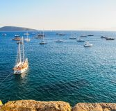 Marvelous blue water Aegean sea with a lot of yachts and boats.  stock image