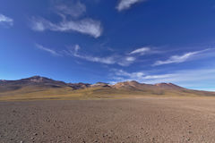 Marvelous desert scenery with volcanic mountains under a gorgeou Stock Photos