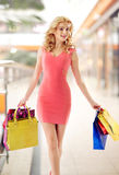Marvelous lady walking with shopping bags Royalty Free Stock Images