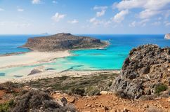 Marvelous landscape of a rocky hill, Balos beach with fantastic white sand and three seas: Ionian, Aegean and Libyan. Great summer. Day. Popular touristic stock photography