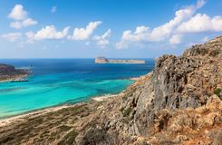 Marvelous landscape of a rocky hill, Balos beach with fantastic white sand and three seas: Ionian, Aegean and Libyan. Great summer. Day. Popular touristic royalty free stock image