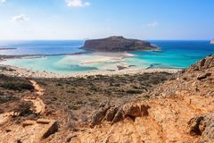 Marvelous landscape of a rocky hill, Balos beach with fantastic white sand and three seas: Ionian, Aegean and Libyan. Great summer. Day. Popular touristic stock photo