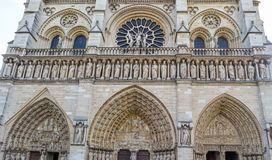 Marvelous sculptural and architectural details of Notre Dame Cathedral in Paris France.  royalty free stock image
