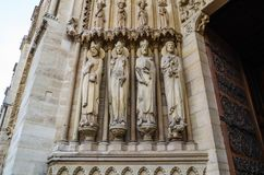 Marvelous sculptural and architectural details of Notre Dame Cathedral in Paris France.  royalty free stock photo