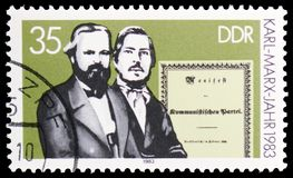 Marx and Engels, Manifesto, 100th death anniversary of the philosopher Karl Marx serie, circa 1983. MOSCOW, RUSSIA - MARCH 23, 2019: Postage stamp printed in stock images