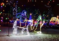 Mary και Joseph που οδηγούν σε έναν γάιδαρο Στοκ Εικόνες
