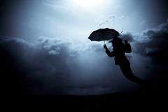Mary. Flying girl with umbrella in blue sky Royalty Free Stock Photo