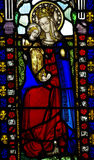 Mary with baby Jesus in her arms (stained glass) Royalty Free Stock Images