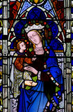 Mary with baby Jesus in her arms (stained glass) Stock Images