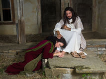 Mary of Bethany anointing Jesus feet. Mary Magdalene crying of shame and embalming Jesus` feet Royalty Free Stock Photography
