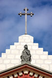 Mary and the Cross. Statue of Mary over the Santa Barbara Mission in California stock photography