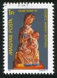 Mary die de zuigeling verzorgen stock afbeeldingen