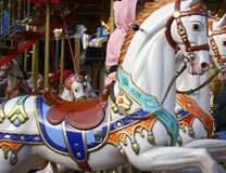 Mary goes around. Carousel's horses Royalty Free Stock Images