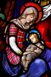 Mary with her child Jesus. Mary and baby Jesusin stained glass Stock Photos