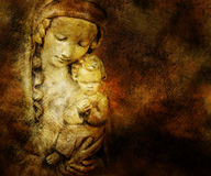 Mary and Jesus. Mary holds the baby Jesus on a highly textured surface with golden colors royalty free stock photo