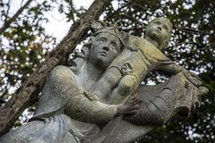 Mary and jesus statue. Old granite sculpture of jesus and mary Stock Images