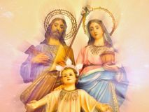 Mary with Joseph and christ child as a family. Sacral representation of the Christ family. In delicate colors and soft background, touching royalty free stock photography