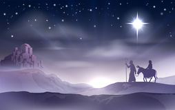 Mary and Joseph Nativity Christmas Illustration. An illustration of Mary and Joseph in the dessert with a donkey on Christmas Eve searching for a place to stay Stock Image