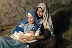 Mary and Joseph nativity scene. Live Christmas nativity scene in an old barn - Reenactment play with authentic costumes. The baby is a property released doll royalty free stock photography
