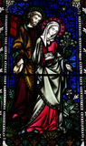 Mary and Joseph in stained glass Stock Photo