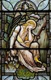 Mary Magdalene i målat glass Arkivfoto