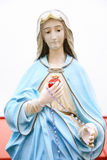 Mary Magdalene. Virgin Mary Magdalene statuette with rosary royalty free stock photography