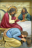 Mary Magdalene washes the feet of Jesus. Relief on the church altar royalty free stock image