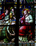 Mary Magdalene washing the feet of Jesus (stained glass) Stock Photos